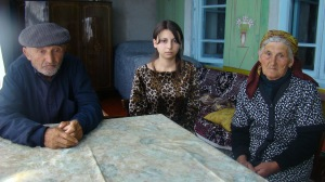 Mariam with her grandfather and grandmother
