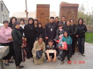Ter Armash & beneficiaries in yard of Ninotsminda Surb Sargis Church 1.jpg