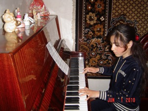Yeghisabet playing piano